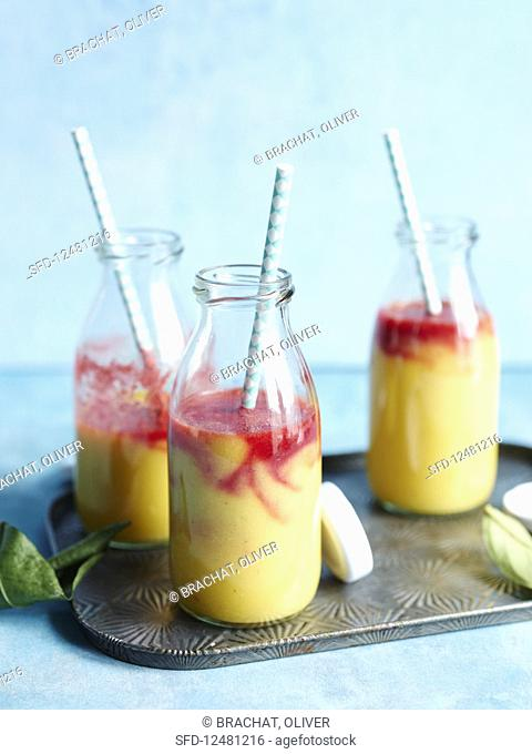 'Rising sun' orange smoothies with raspberries