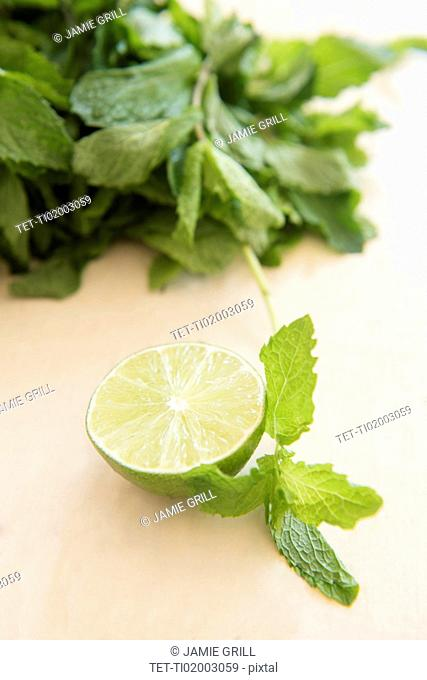 Mint and halved lemon on table