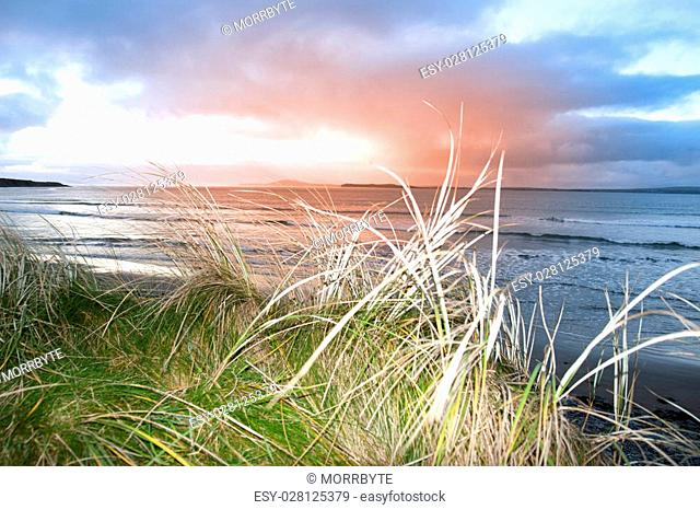 a beautiful view from the sand dunes of Beal beach and sunset in county Kerry Ireland