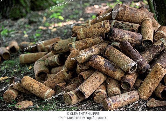Pile of rusty First World War One artillery grenade shells, dug up in WWI battlefield in West Flanders, Belgium