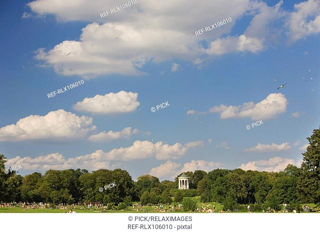 People sunbathing in front of the Monopteros, English Garden, Munich, Germany