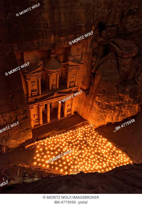 Candles in front of the Pharaoh's treasure house, struck in rock, at night, view from above into the gorge, facade of the treasure house Al-Khazneh