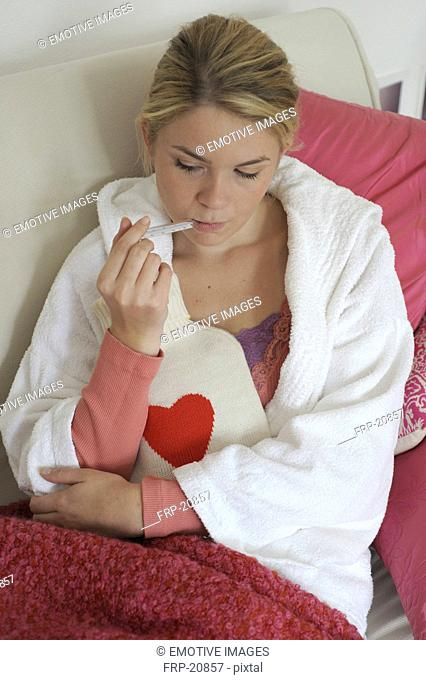 Woman taking her temperature