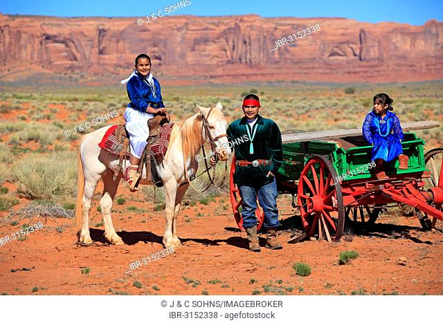 Navajo Indian family with a horse and carriage, Monument Valley, Utah, United States