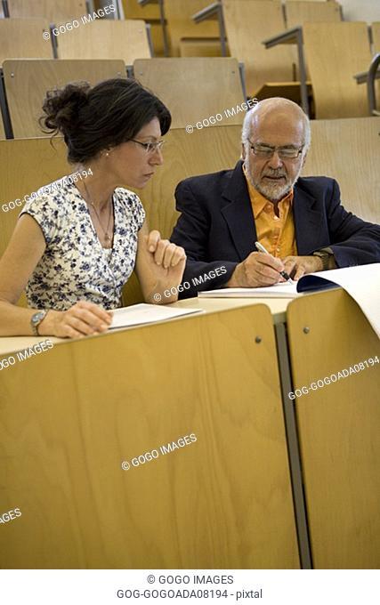 Teachers talking in empty classroom
