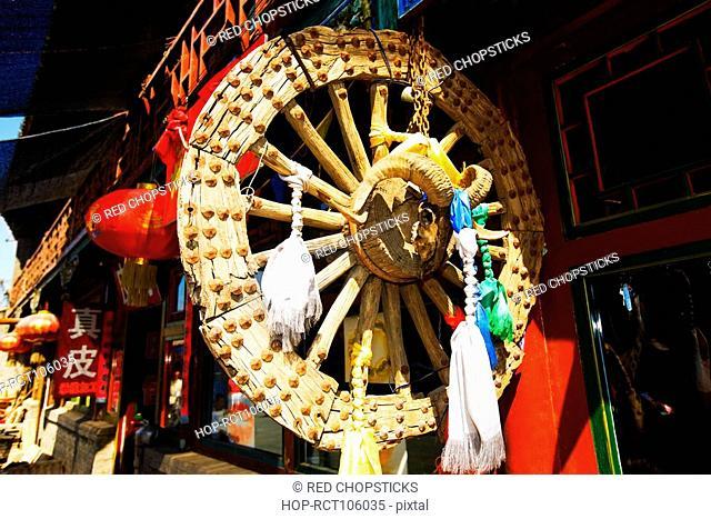 Chinese lanterns and wheel at a market stall, HohHot, Inner Mongolia, China