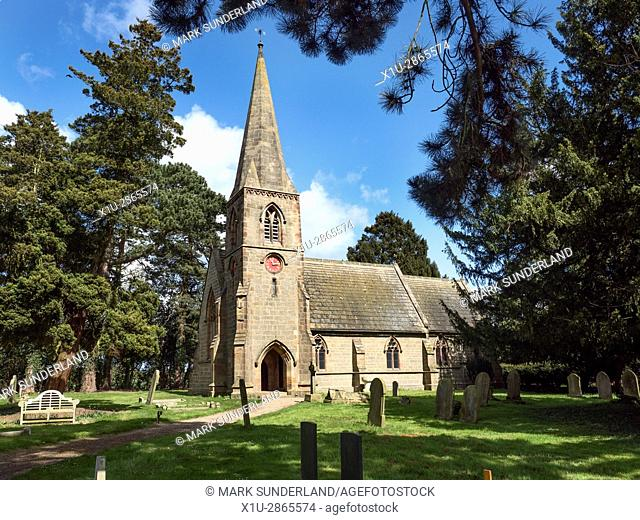 Church of St Mary with its Distinctive Red Clock Face at Lower Dunsforth Yorkshire England