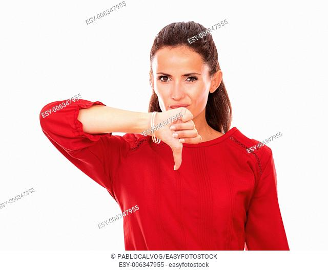 Portrait of single latin woman with badly done gesture looking at you on isolated studio