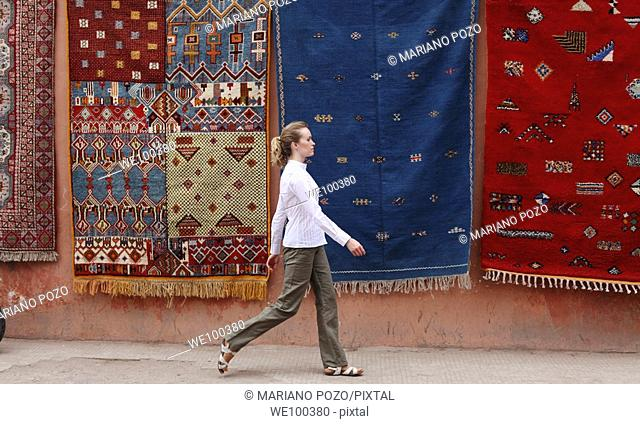 Street scene, young woman walking, Marrakesh, Morocco, Africa