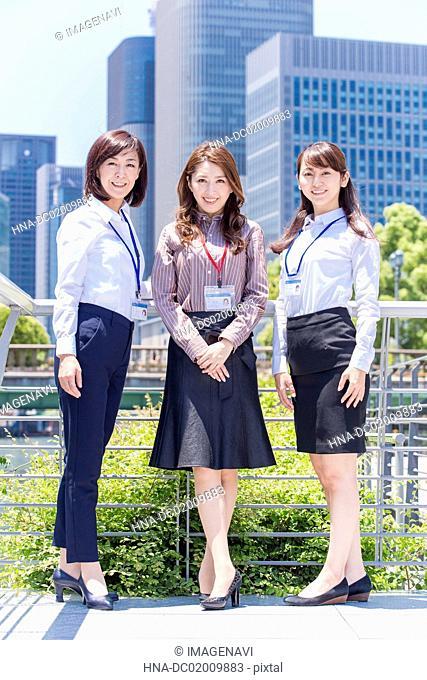 Business women standing outside