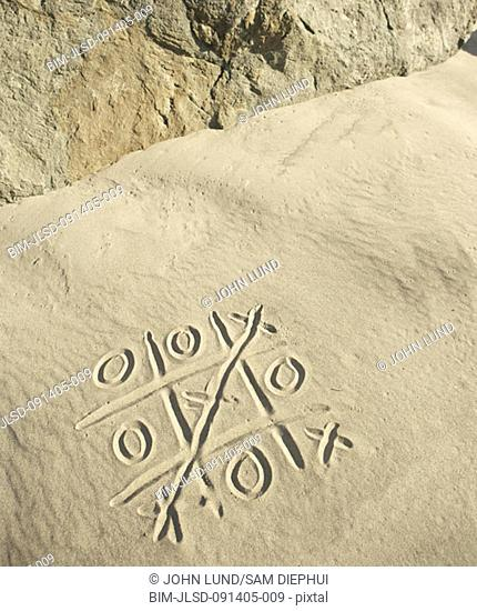 Tic-tac-toe drawn in sand