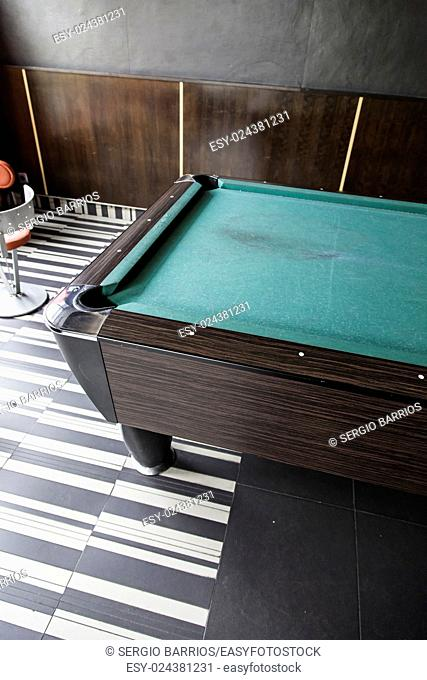 Pool table in a bar, detail of a board game, competition
