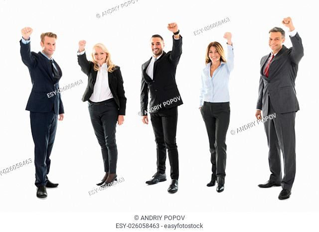 Full length portrait of cheerful business people celebrating success against white background