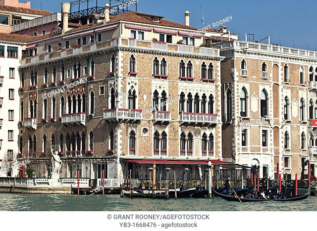 A Gondola passes by The Bauer Palazzo Hotel on The Grand Canal, Venice, Italy