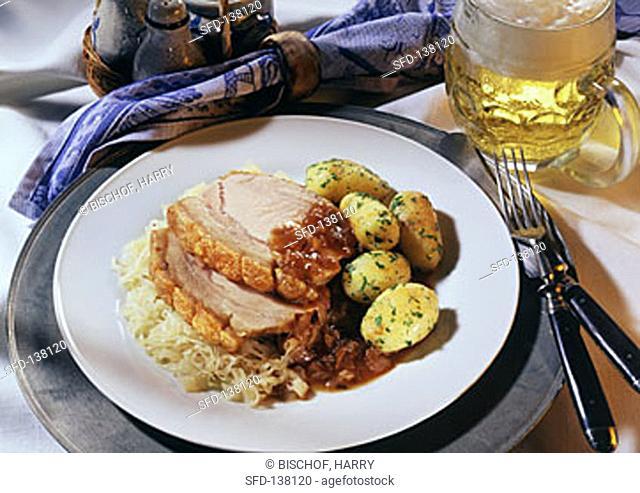 Sliced Pork over Saurkraut, Roasted Potatoes