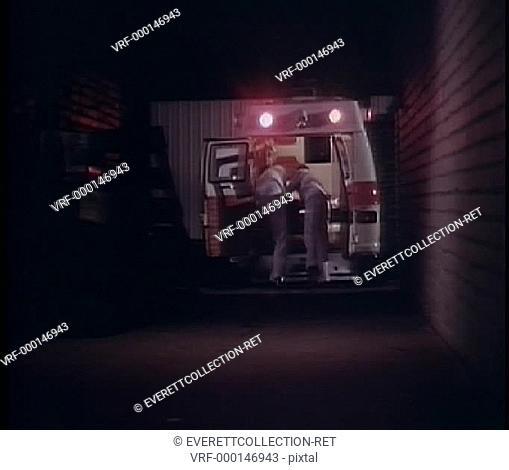 Medical attendants closing back doors of ambulance