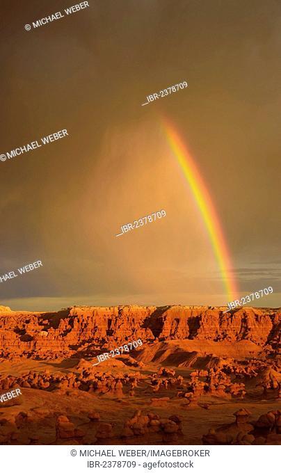 Rainbow during a thunderstorm, eroded hoodoos and Entrada Sandstone rock formations, Goblins, Goblin Valley State Park, San Rafael Reef Desert, Utah