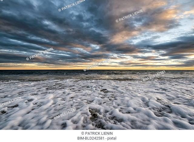 Foam in waves on ocean beach
