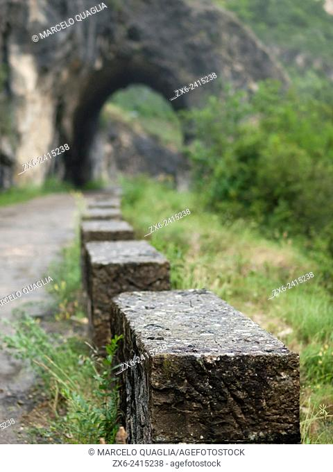 Stone fence on a country road at Terradets Dam. Noguera Pallaresa River at Montsec Hills. Cellers village countryside. Pallars Jussà region, Lleida province