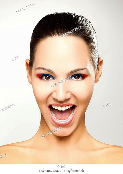 fashion portrait of a beautiful young woman with mouth open