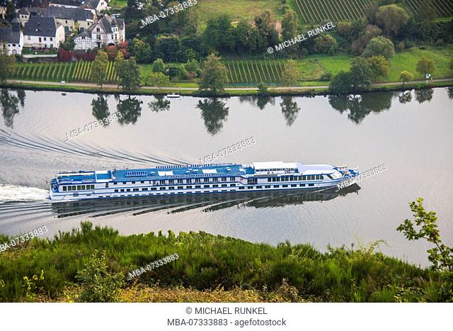 the Vineyards around Piesport and a cruise ship on the Moselle river, Moselle valley, Rhineland-Palatinate, Germany