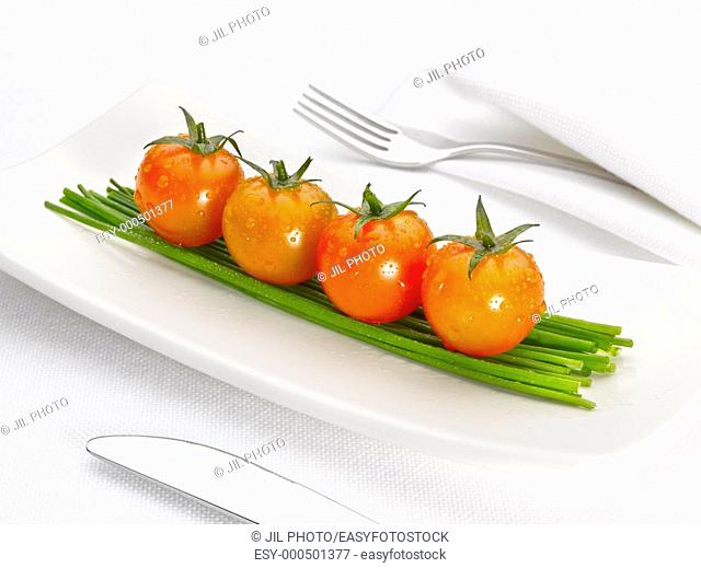 four tomatoes over onions