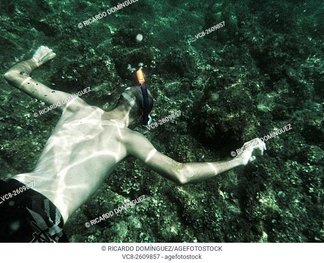Snorkel man underwater