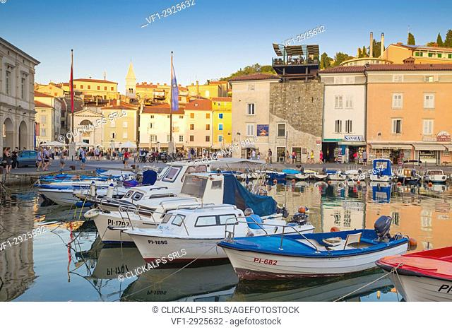 Piran, Slovenian Istria, Slovenia. . The harbour at sunset with some colorful fishermen boats