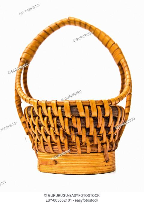 A yellow wicker basket isolated on white background