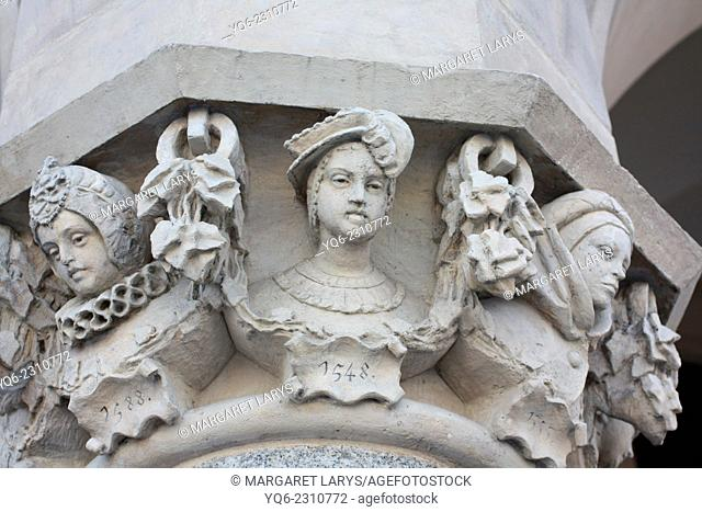 Details of curved heads designed by Jan Matejko (1876-1879) a famous Polish artist, on the columns of the Cloth Hall (Polish: Sukiennice) in Kraków