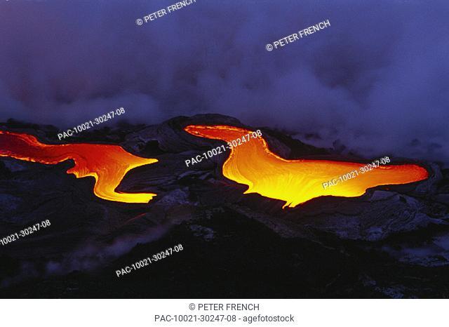 Hawaii, Big Island, Hawaii Volcanoes National Park, Pahoehoe glowing lava flow, 'river like' smoke in background