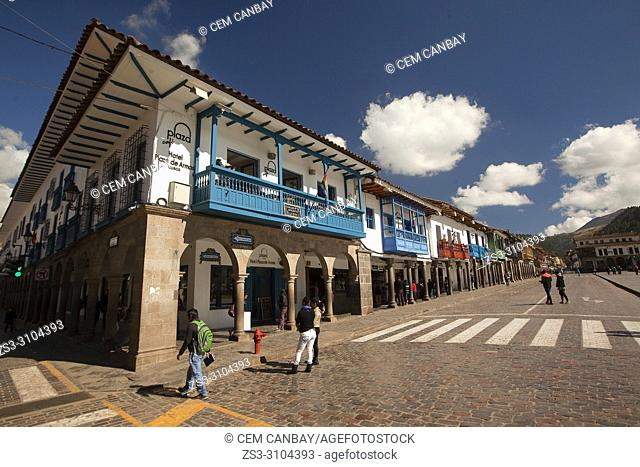 Colonial buildings with balconies at the Plaza de Armas Square at the historic center, Cusco, Peru, South America