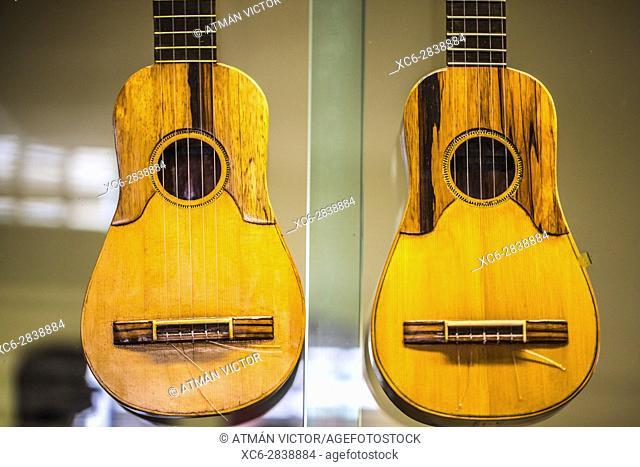 A pair of hanging spanish guitars