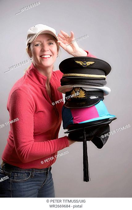 Woman Holding A Selection Of Hats Business And Pleasure