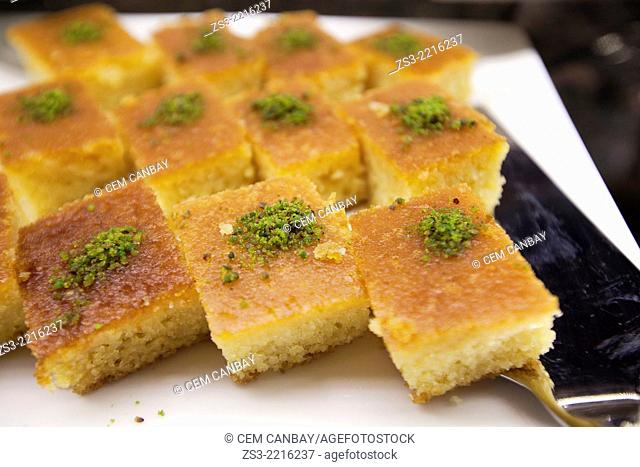 Revani, turkish dessert consisting of a mixture of semolina, wheat flour, eggs, sugar, oil, yogurt and lemon at the pastry shop, Taksim, Istanbul