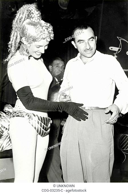 The Italian director Alberto Lattuada with an actress on the set of the film Anna