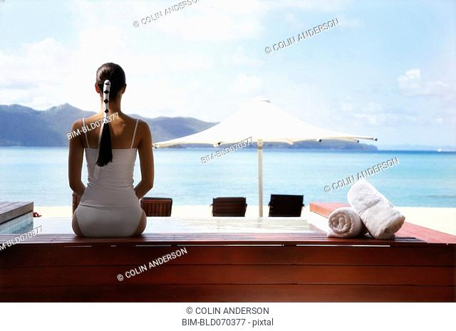 Pacific Islander woman looking out over beach