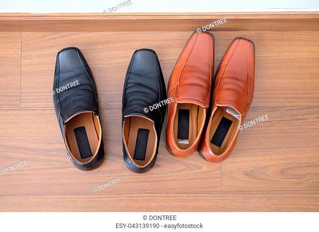 Men shoes (black and brown) on wood floor