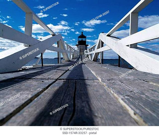 Wooden walkway leading to a lighthouse, Marshall Point Lighthouse, Port Clyde, Maine, USA