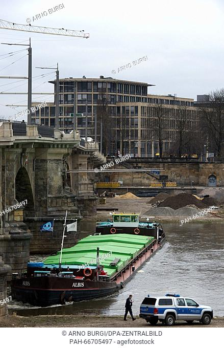 A Czech freighter pictured in front of the pillars of Albert Bridge on the Elbe river in Dresden, Germany, 15 March 2016