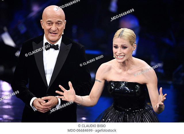 Italian host and comedian Claudio Bisio with swiss host Michelle Hunziker during the second evening of the 69th Sanremo Music Festival