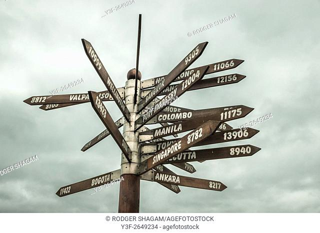 A sign giving directions and distances globally. Erected on the southern Cape coast in South Africa