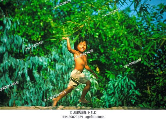 Vietnam Mekong Delta little boy waving friendly from dike
