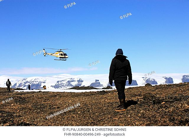 Tourists waiting for arrival of helicopter, Devil Island, Weddell Sea, Antarctica, December