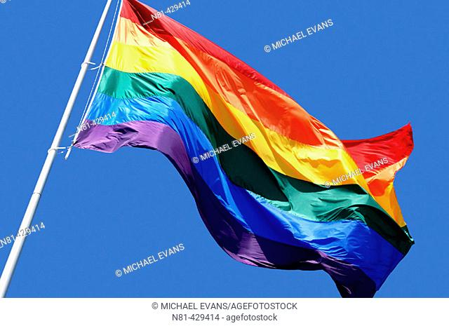 Rainbow flag waving over Castro District in San Francisco. California, USA