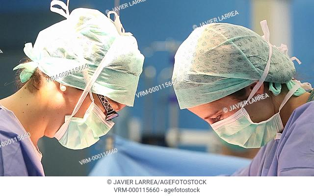 Surgeons in operating theatre , Hip replacement surgery, Orthopedics and Trauma surgery , Hospital