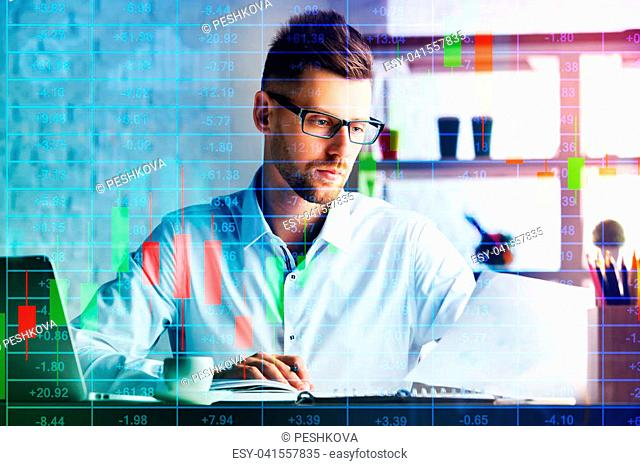 Handsome businessman working on project at modern workplace with abstract forex chart. Toned image. Finance and technology concept. Double exposure