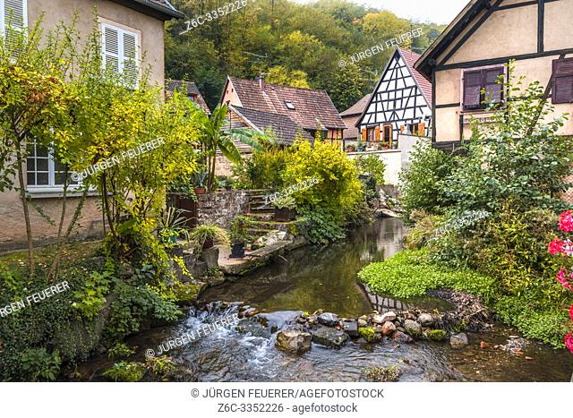 village Andlau, Alsace Wine Route, France, natural brook between timbered houses