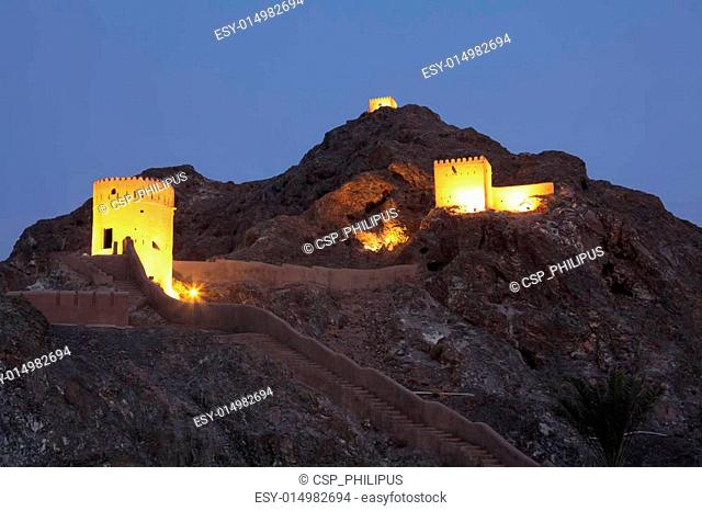 Old fortress in Muscat illuminated at night, Sultanate of Oman
