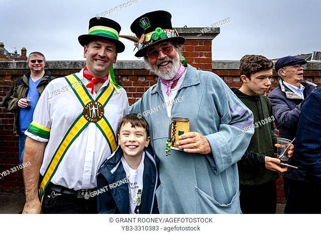 A Three Generation Morris Dancing Family Pose For Photos At The Annual â. . Dancing in the Oldâ. . In Harveys Brewery Yard To Celebrate The Return Of The â